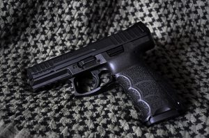 Heckler__Koch_SFP9_handgun_on_neutral_background-300x199
